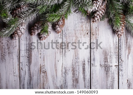 White shabby Christmas border with snow covered pinecones - stock photo
