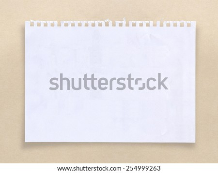 White sheet of paper for your message on brown background, with clipping path. - stock photo