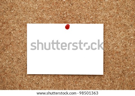 white sheet of paper pinned to cork  bulletin board - stock photo