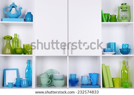 White shelves with colorful things, close-up - stock photo