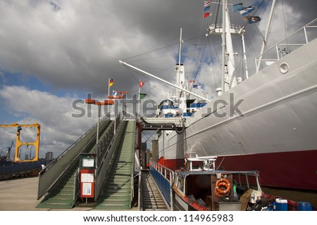 white ship on the dock with the ladder - stock photo