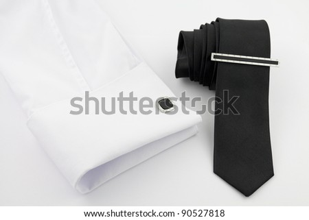 White shirt and black tie on white - stock photo