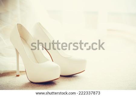 White shoe of the Bride . wedding theme background - stock photo