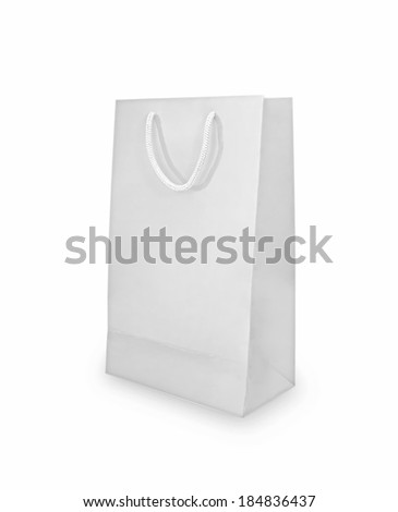 White shopping paper bag isolated on white with shadow - stock photo