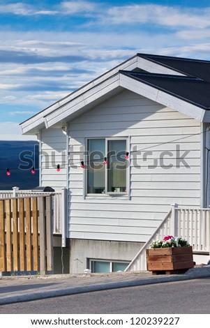 White Siding Icelandic House at Sunny Day. Vertical Shot - stock photo