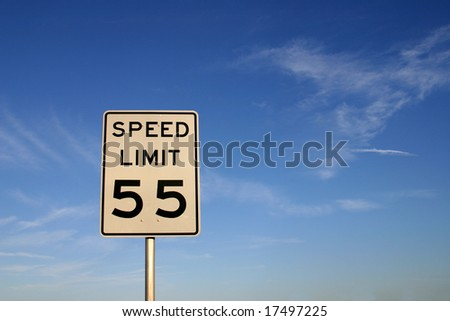 """White sign with """"speed limit 55"""" printed in black. Sign is shot against a blue sky. PHOTO ID: SpeedLimit5500016 - stock photo"""