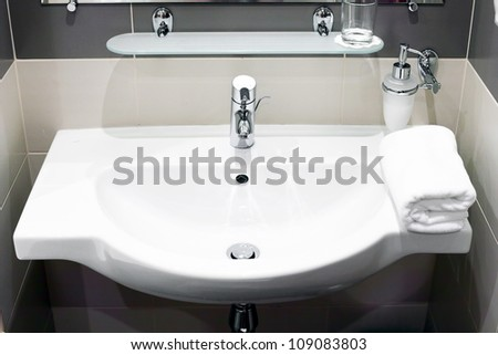 White  sink and towell in SPA salon. - stock photo