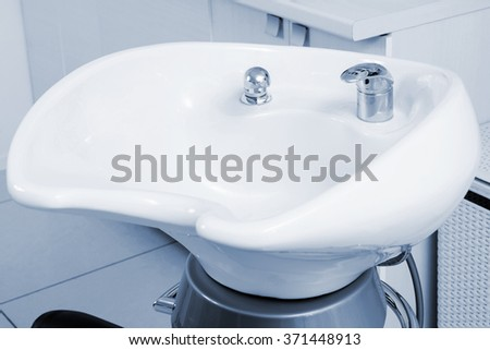 white sink in a modern barber shop - stock photo