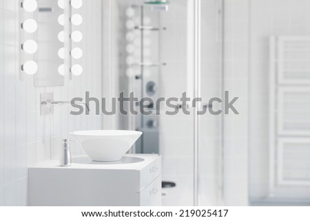 White sink in a modern bathroom with water tap and mirror - stock photo