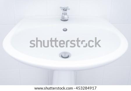 white sink ,Washbasin sink in a bathroom - stock photo