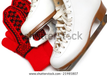 White skates and red mittens - stock photo