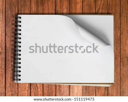 White sketch book one page Horizontal on Wood table background - stock photo