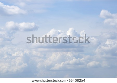 White Sky and Puffy Clouds - stock photo