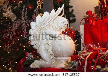 White small Angel, Traditional decorations for Christmas tree, gred and green combination, Czech republic - stock photo