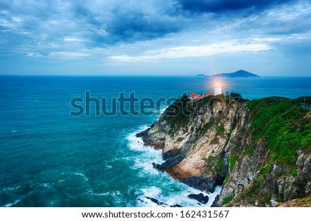 White small lighthouse. Hong Kong - stock photo
