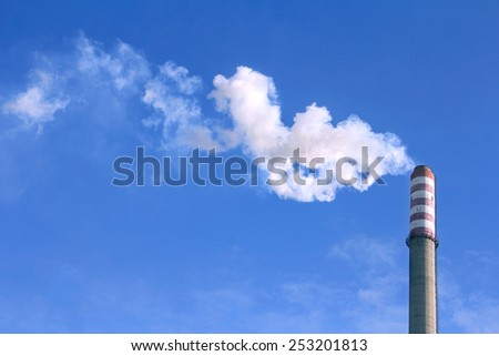 White smoke clouds from a high heating plant chimney  - stock photo