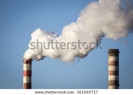 White smoke over high CHP chimney - stock photo