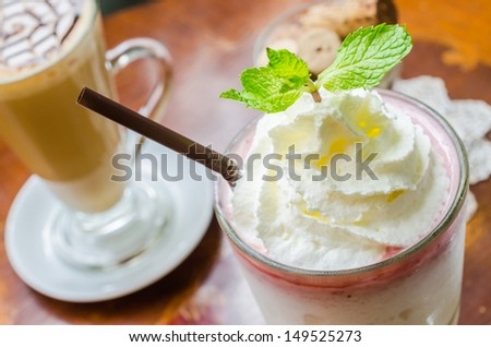 White smoothie with cream on top - stock photo