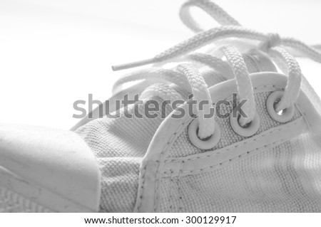 White sneakers running shoes with tied laces - stock photo
