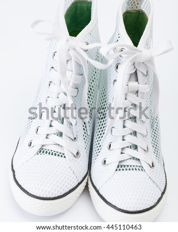 White sneakers with green decoration  - stock photo