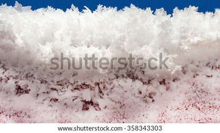 white snow in sunny frosty winter and blue sky - stock photo