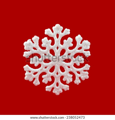 White Snowflake on red background. Winter symbol. Happy New Year! Christmas decoration. - stock photo
