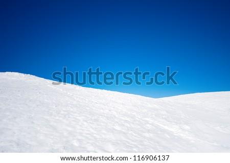 White snowy fields under a blue sky - stock photo