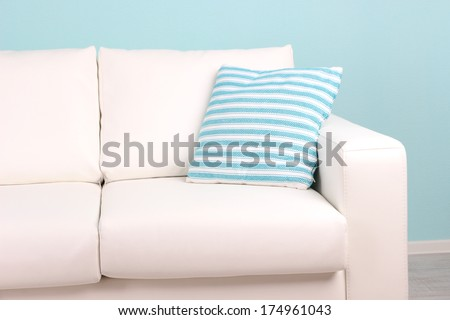 White sofa close-up in room on blue background - stock photo