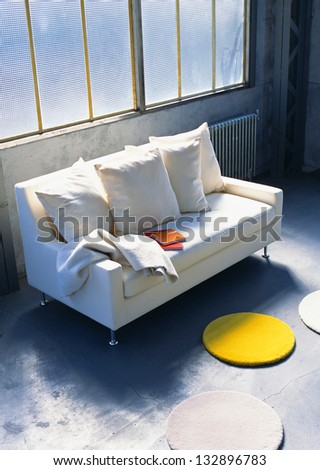 white sofa near the windows - stock photo