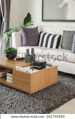 white sofa with wooden table in modern living room at home - stock photo
