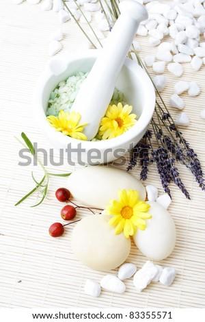 White spa, still life. Wellness concept with organic cosmetics: lavender, rosemary bath salt, marigold soap bars. - stock photo