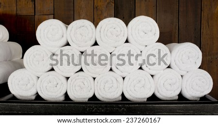 White spa towels pile ready to use. - stock photo