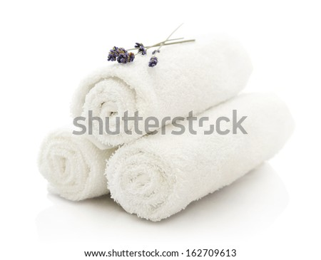 White spa towels pile with lavender on white background - stock photo