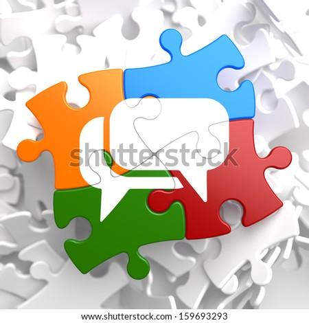 White Speech Bubble Icon on Multicolor Puzzle. Communication Concept. - stock photo
