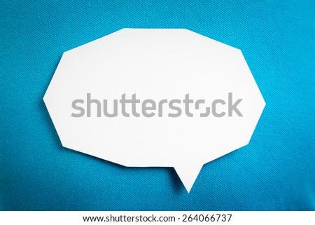 White speech bubble on blue background textured. - stock photo