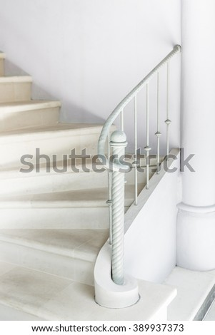 White stairs with vintage white railing - stock photo