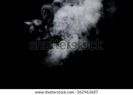 White steam on black background - stock photo