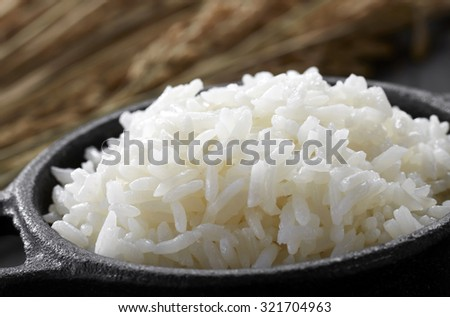 White steamed rice in black round pot   - stock photo