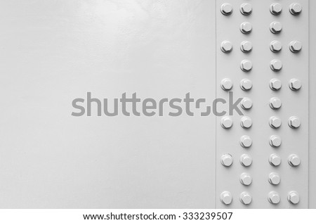 White steel wall with bolts, metal parts connection, automotive bridge fragment - stock photo