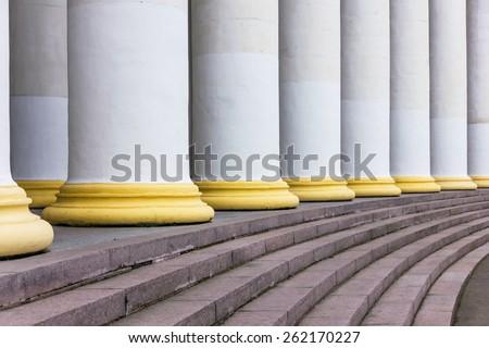 White stone column holds the overlap - stock photo