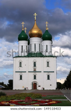 White stone golden-domed orthodox temple in ancient Russian Kremlin - stock photo