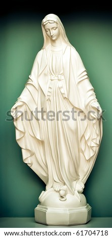 white stone statue of saint Mary - stock photo