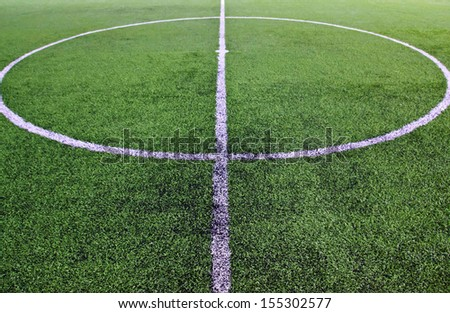 White stripe on the green soccer field - stock photo