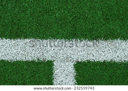 White stripe on the green soccer field - stock photo