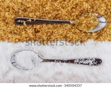 White sugar and brown sugar , and spoon - stock photo