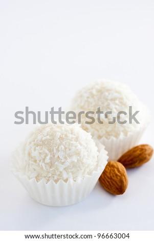 White sweet coconut truffles, close up - stock photo