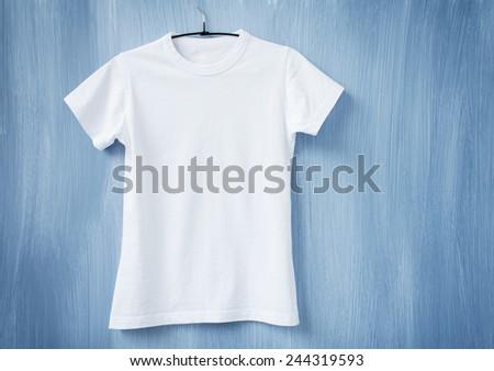 White t-shirt on hanger - stock photo