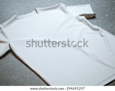 White t-shirt on the concrete background - stock photo