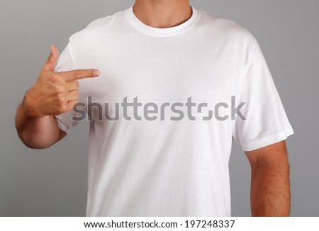 White t-shirt with blank front on man ready for logo or message - stock photo