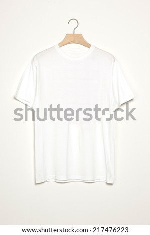 White t-shirts with wood hanger isolated white. - stock photo